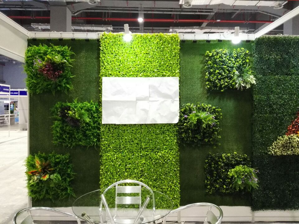 Shot From Our Trade Show This Green Wall Is Fromed With Artificial Grass Artificial Hedging Pane Artificial Grass Wall Artificial Green Wall Artificial Grass