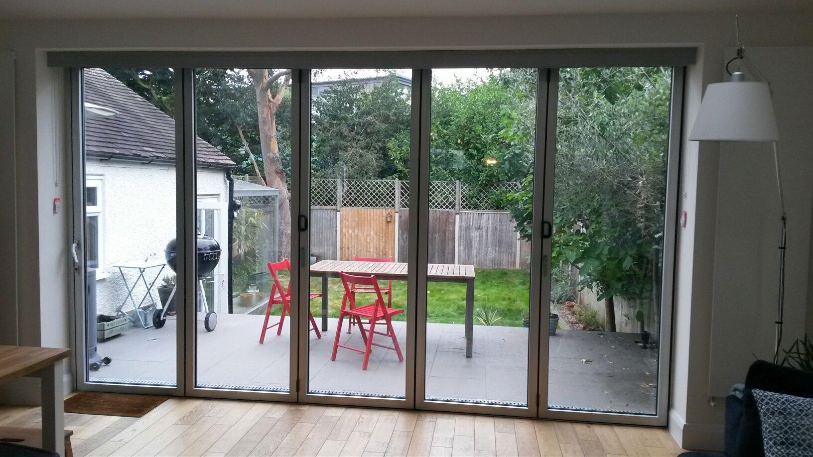Bifold door blinds neatly hidden behind the aluminium pelmet by