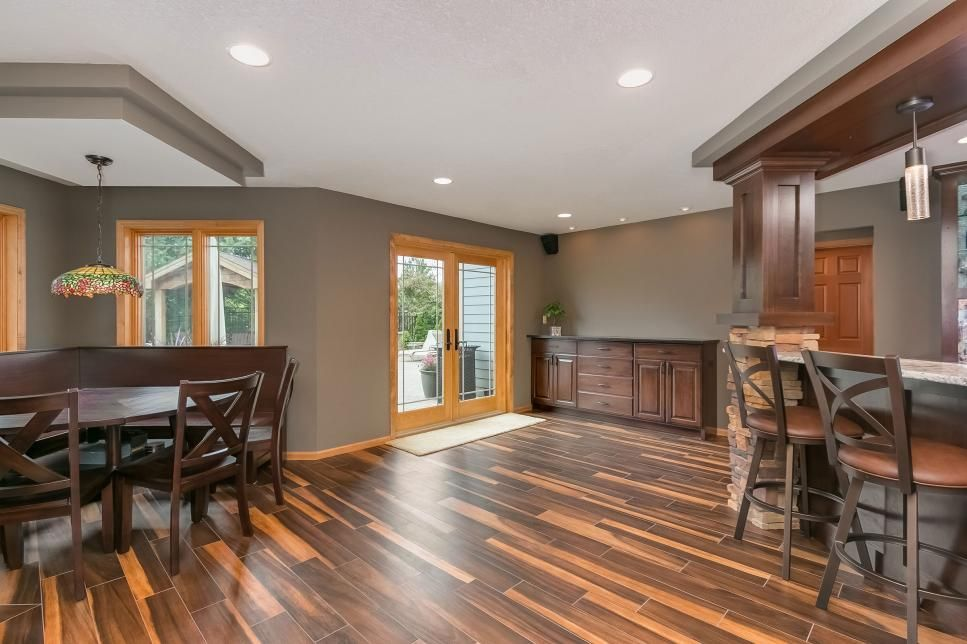 Transitional Basement With Unique Wood Floor Features