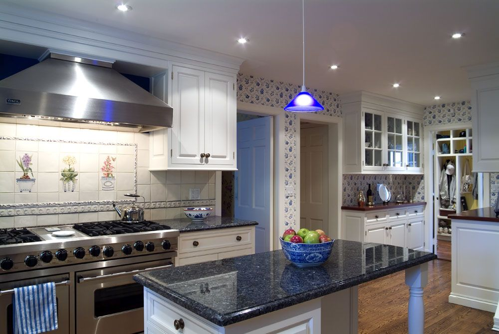 Granite countertops with white cabinets blue granite for Best countertops for white cabinets