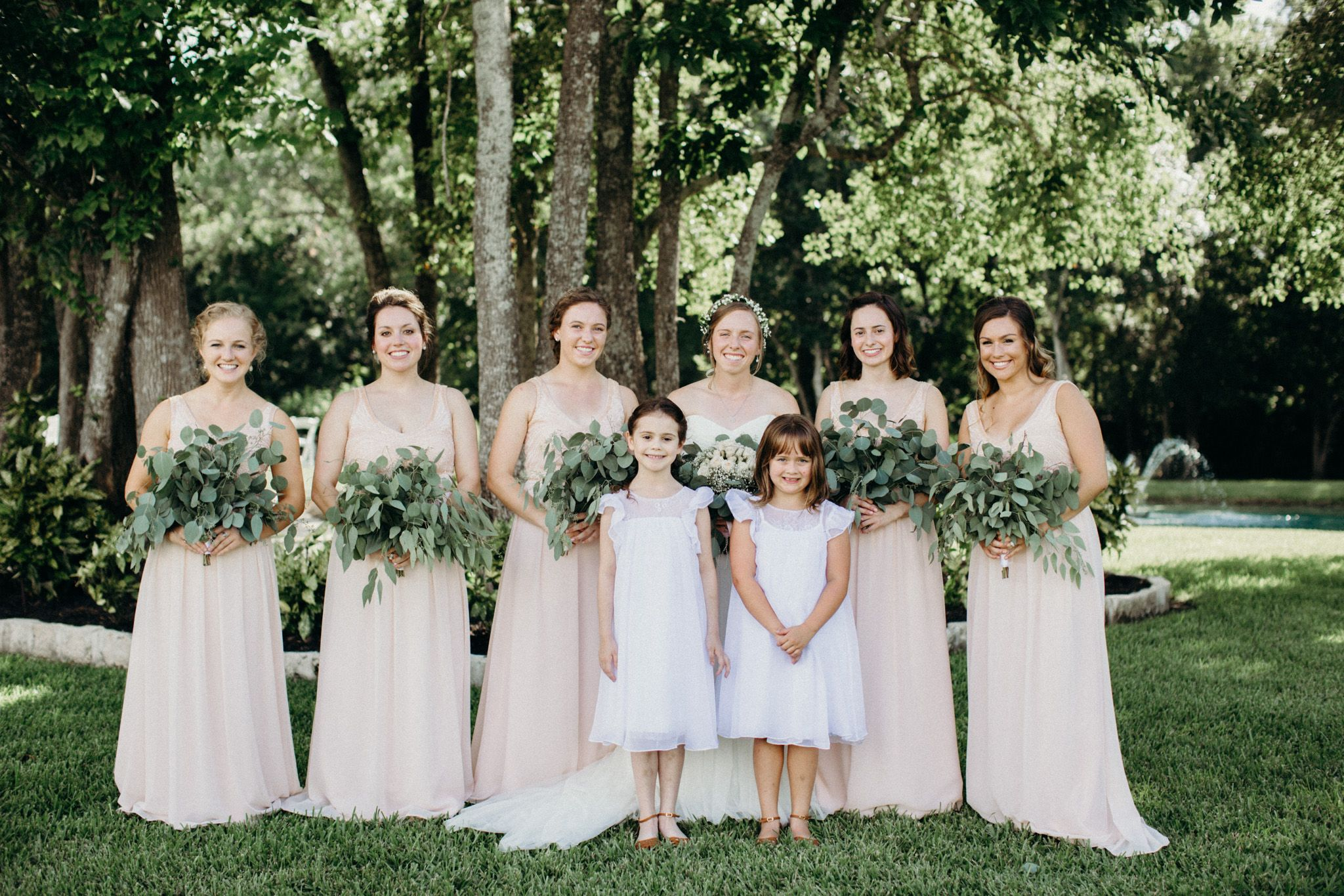 Long, Blush Bridesmaid Dresses And Bouquets With Tons Of