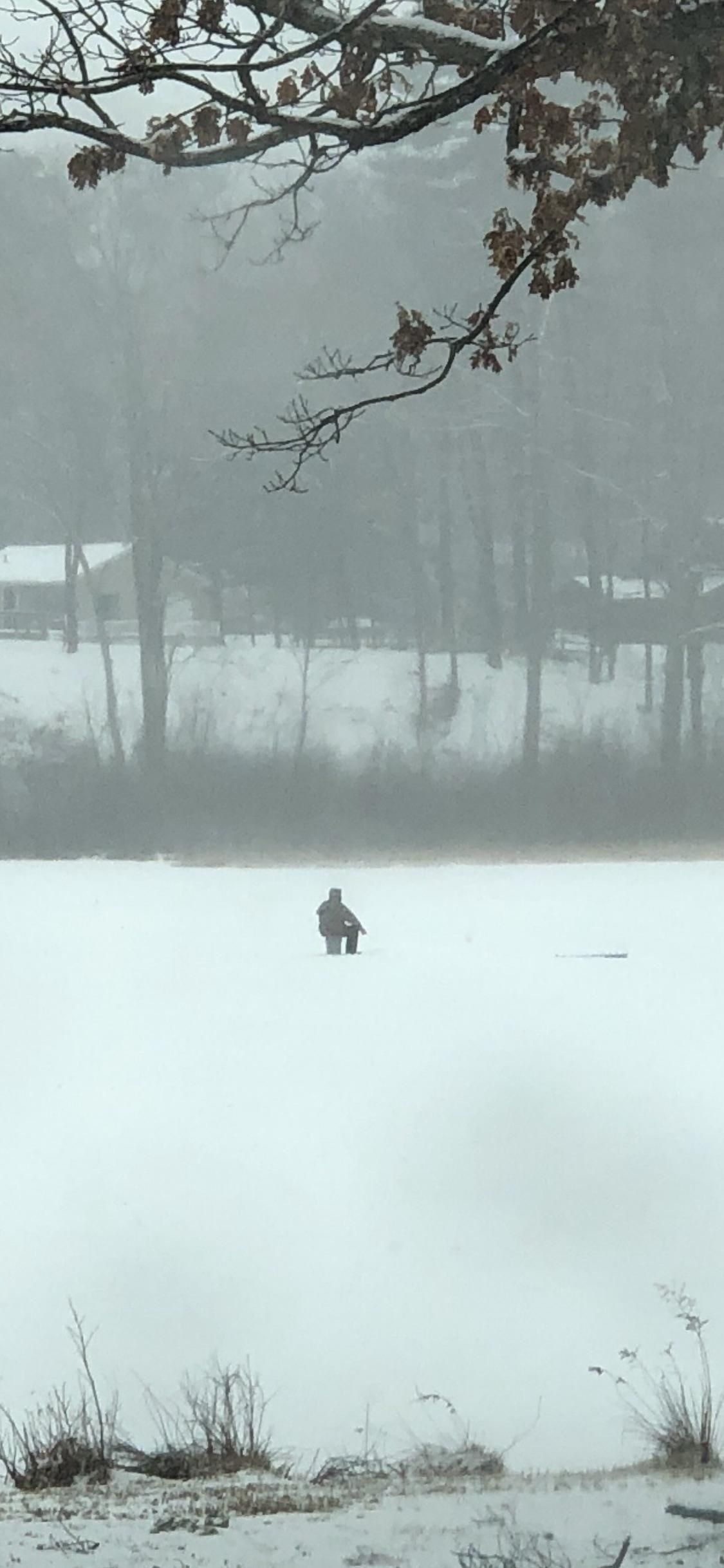 Ice fishing in freezing rain today  Theses guys are hard