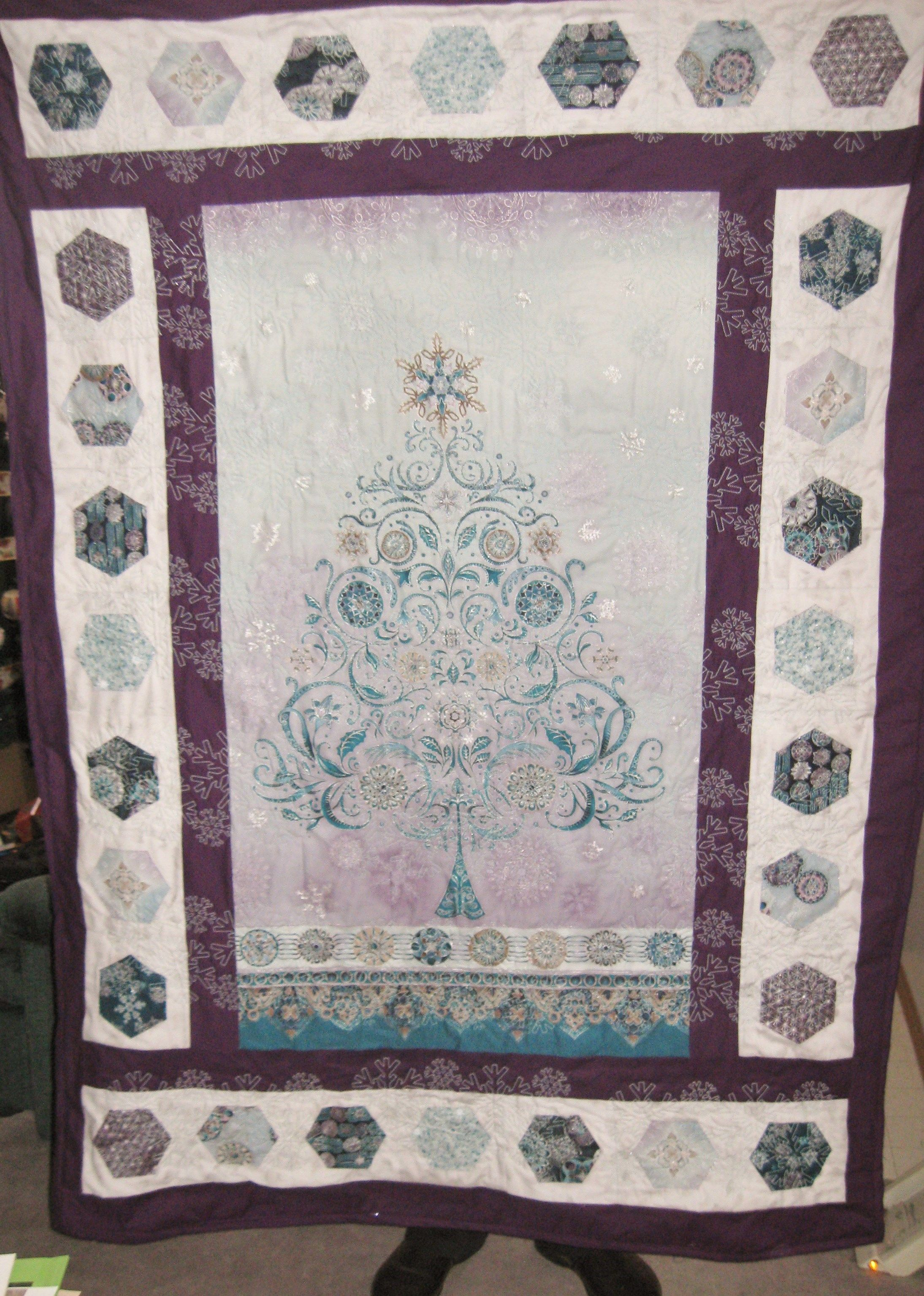 Quilt donated to Airdrie Day Support Program for Silent Auction.  Machine embroidered with white snowflakes.