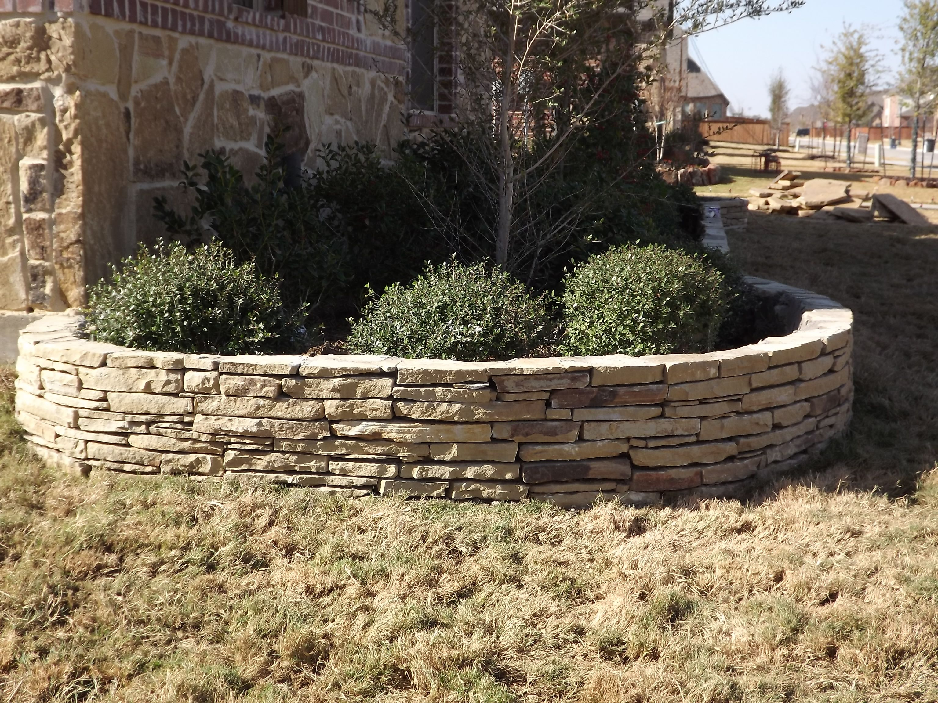 Stacked Stone Flower Bed Edging by C3 Backyard Oasis LLC