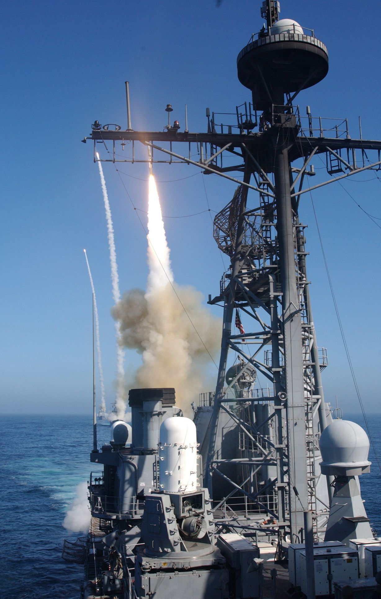 USS Bunker Hill leads two other surface ships firing a standard SM-2 surface-to-air missile near San Diego.