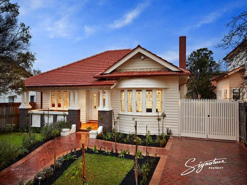 Weatherboard californian bungalow house exterior with bay windows