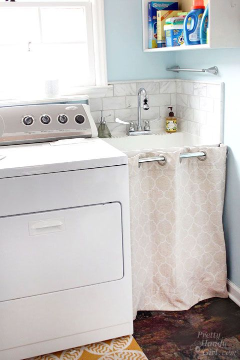 hidden storage under a laundry room sink - Utility Sink Backsplash