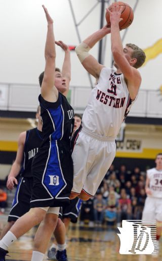South Western's Mike Duffy, right, shoots over Dallastown defender Andrew Henry during the York-Adams League semi-final basketball game, Wednesday February 13, 2013.  John A. Pavoncello photo - jpavoncello@yorkdispatch.com