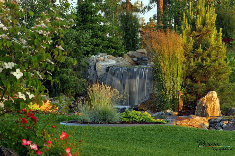 Awesome waterfall design in a beautiful yard with fresh for Stunning garden designs