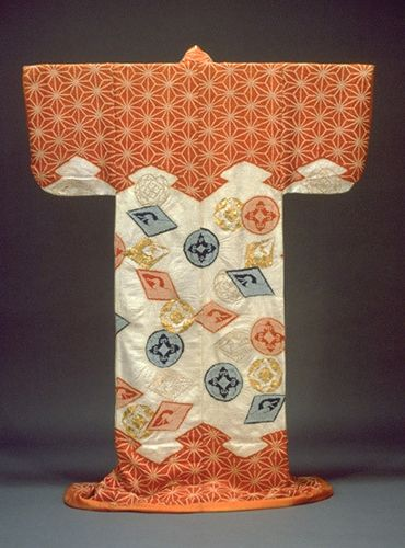 """Kosode (Short-Sleeved Kimono) with Pine Bark Lozenges, Hemp Leaf Design, and Scattered Crests in Tie-dyeing and Embroidery on Parti-colored, Figured-Satin Ground"", 18th century, Japan.  Kyoto National Museum."