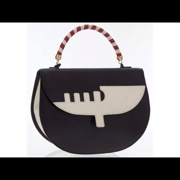 SOLD Moschino Black & White Leather Venice Bag Sold on eBayWith the inspiration of one of Italy's most famous and beautiful cities, and by one of the most stylishly Italian names, this bag is the perfect accessory to add to a look for a fun take on a classic style. Done in black leather, featuring a white leather silhouette of a canal boat, this bag is effortlessly chic. Featuring red and white rolled leather handle, gold tone hardware, hook clasp closure, black canvas and one zip pocket…