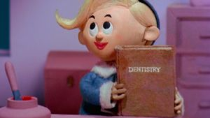 Christmas Dentist Elf.Hermey The Elf Holding A Book About Dentistry Catch