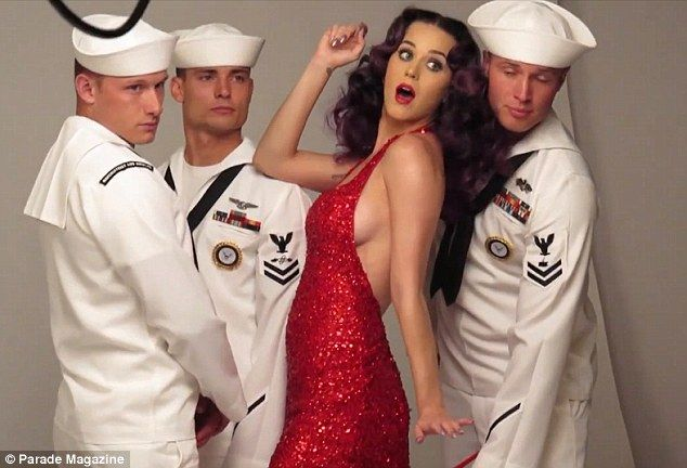 Her very own fleet week! Katy looked delighted to be with the naval men as she larked about