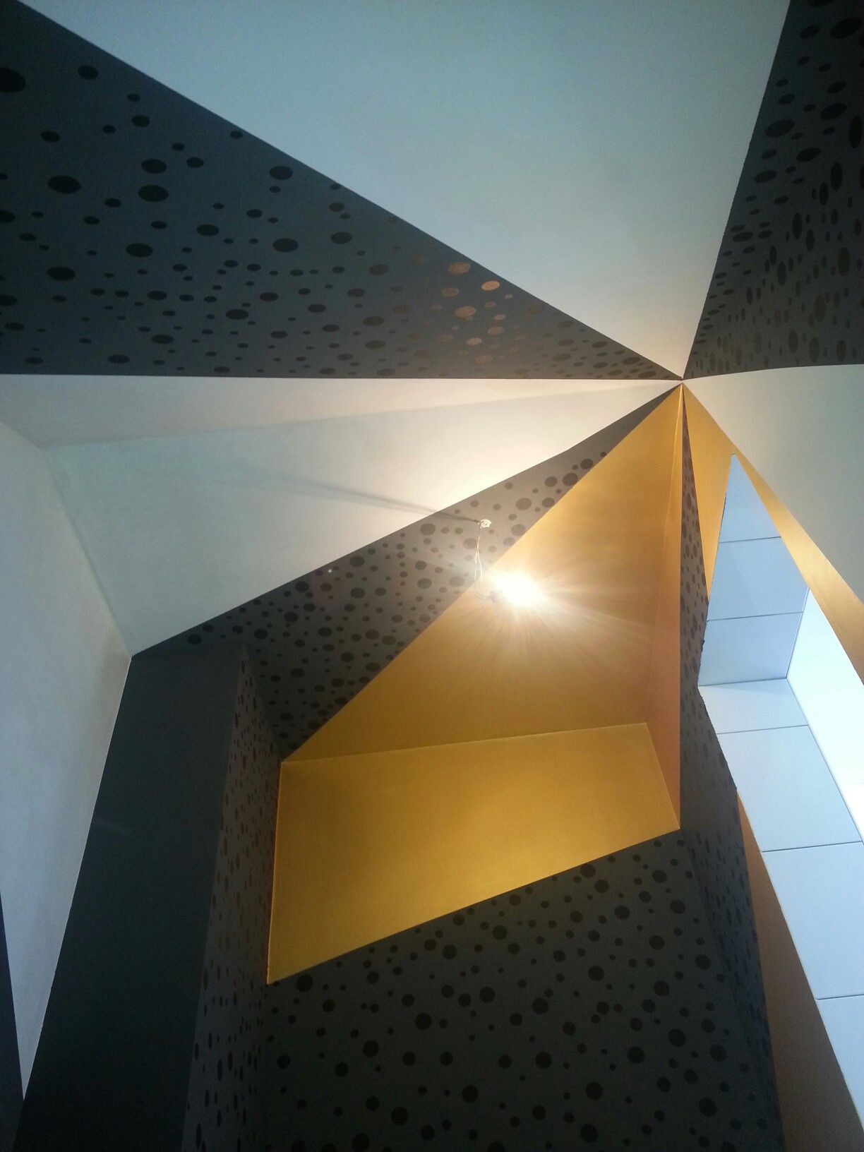 Ceiling of a walk in closet.  Dark grey with small and big black dots, pure gold and not so white.  I love it.  Can't wait to install shelves and racks ¦D
