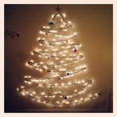 I Made This Christmas Tree Out Of One Strand Of Lights Attached To The Wall With Clea Wall Christmas Tree Christmas Tree Made Of Lights Christmas Tree Lighting