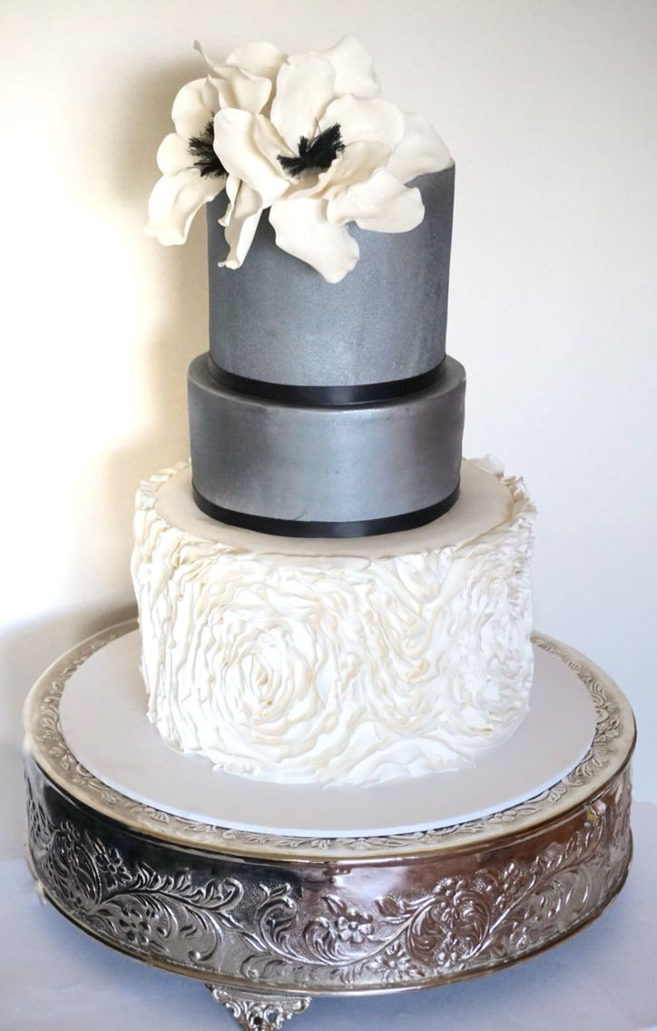 Modern silver wedding cake frill tier and sugar flowers cakes by
