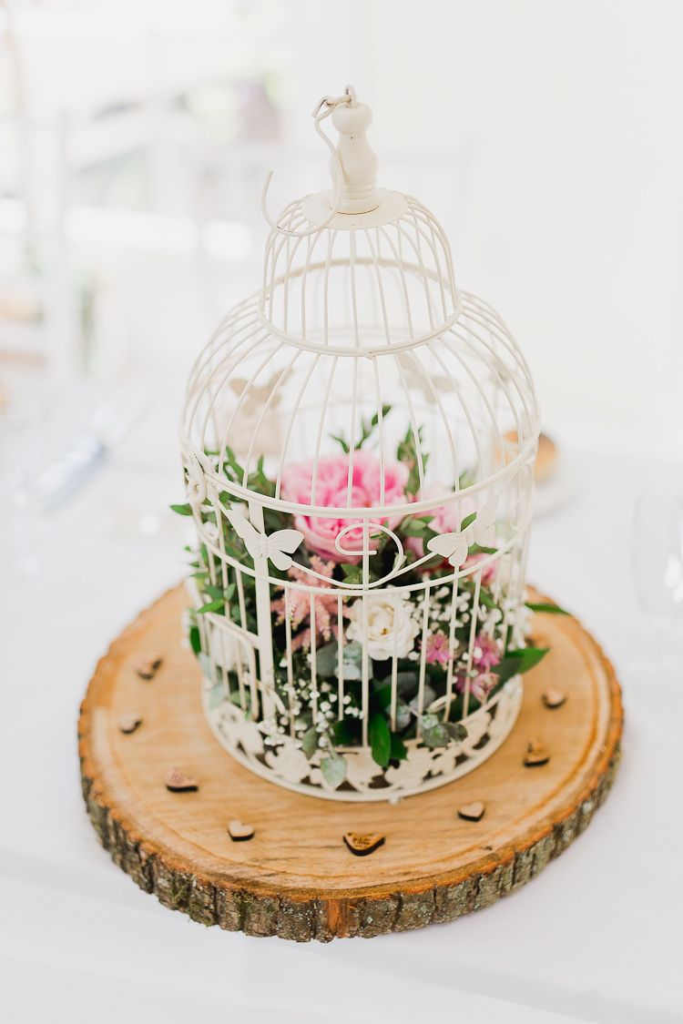 33 Elegant Birdcage Wedding Centerpieces A Bird Cage Ona Wood Slice With Pink And White Blooms Foliage