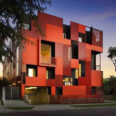 red facade filled with empty & full spaces | apartemen