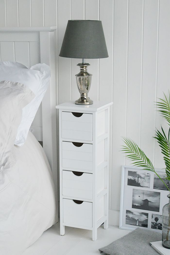 Dorset Tall White Slim Bedside Table With 4 Drawers At 20cm Wide Shown Beside A Bed And Narrow White Bedside Table White Bedside Table White Bedroom Furniture