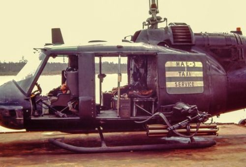 """A Bell UH-1 of the US Navy Helicopter Attack (Light) Squadron 3 Seawolves (or HA(L)-3 Seawolves). The """"taxi service"""" sign was made soon after the crew discovered they would be transporting a dignitary around the Mekong Delta area. The sign was taken..."""