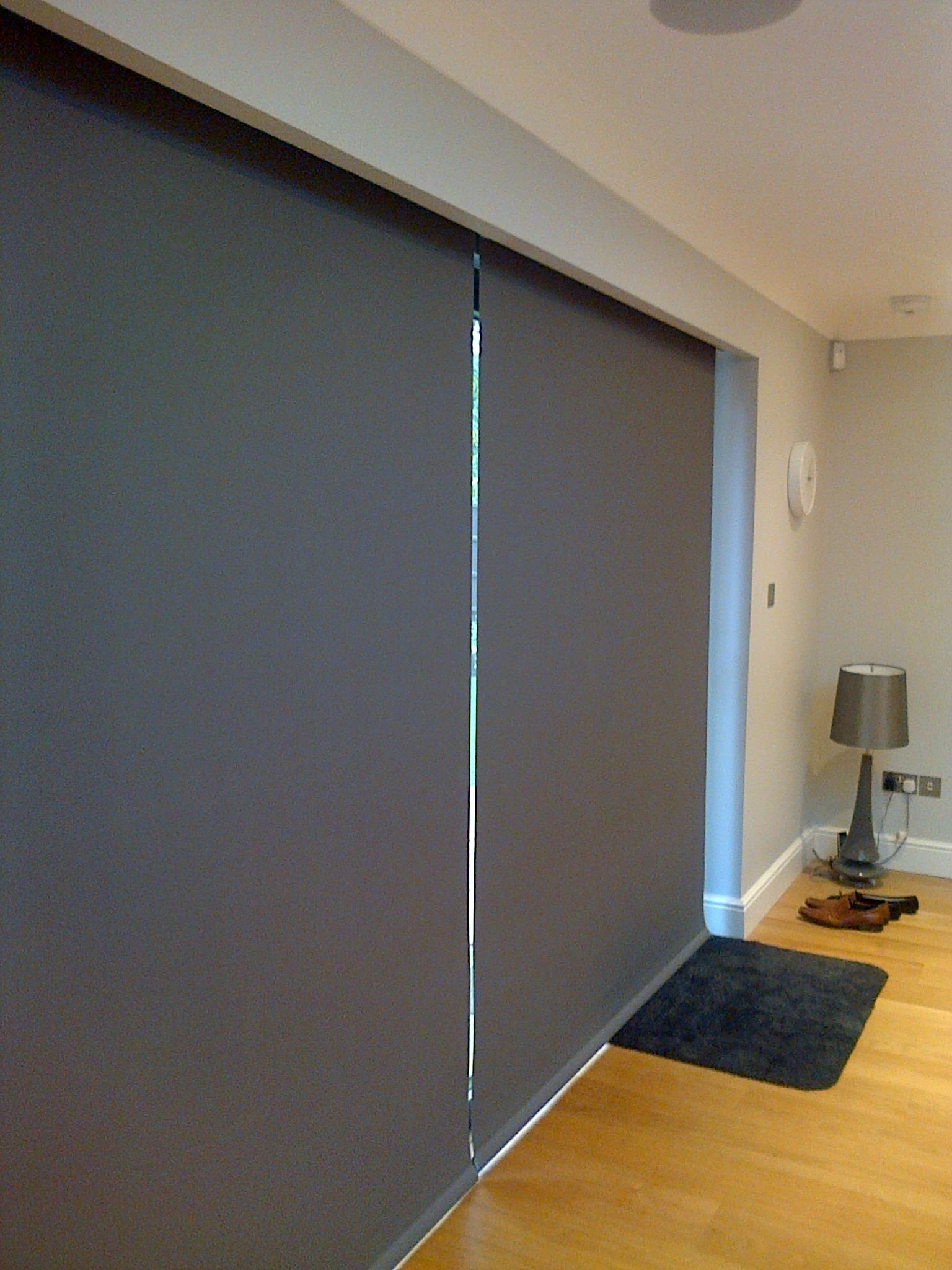 Keep the heat in next to your bifold doors with electric blinds from