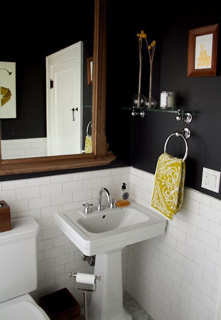 subway tile + pedestal sink + navy