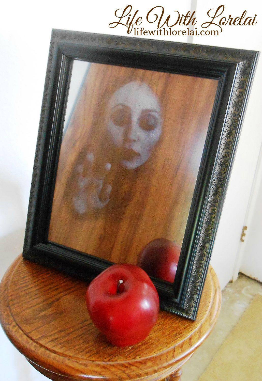 Create a haunted halloween mirror with a hidden face inside - halloween diy decor