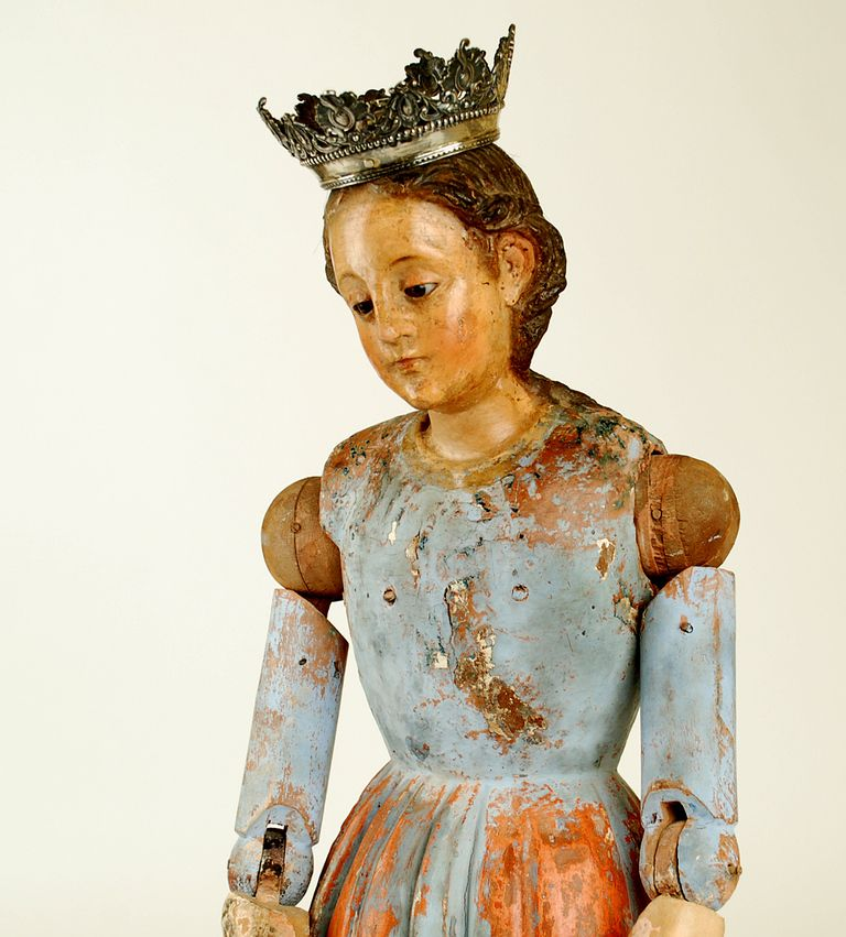 A magnificent late 18th century Spanish colonial Madonna - carved from a single timber with inset glass eyes, articulated arms; jointed both at the shoulder and elbow. Fitted with a Spanish colonial silver crown.