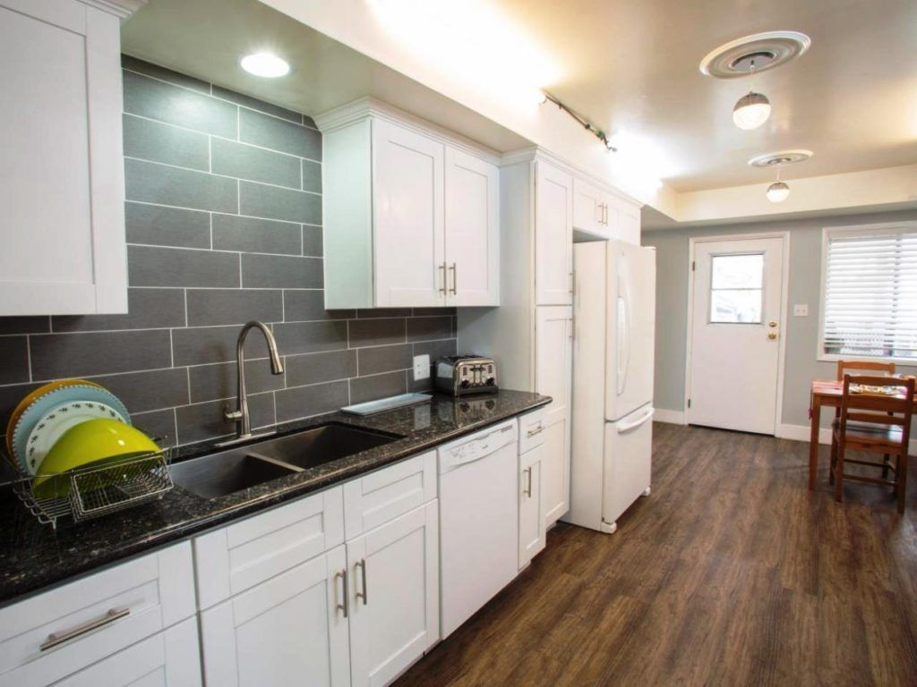 White kitchen cabinets and grey countertops kitchenlaundrypantry