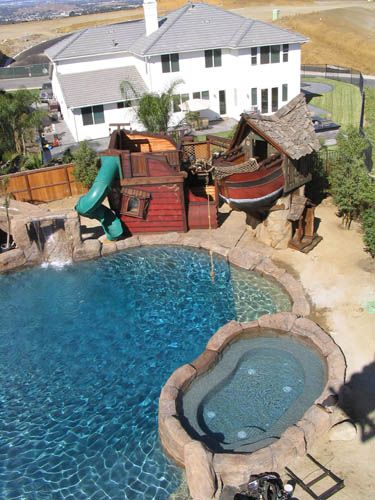 Custom Tree Houses - Custom: Pirate Oasis - What is the natural environment for a Pirate Ship play house? Water!