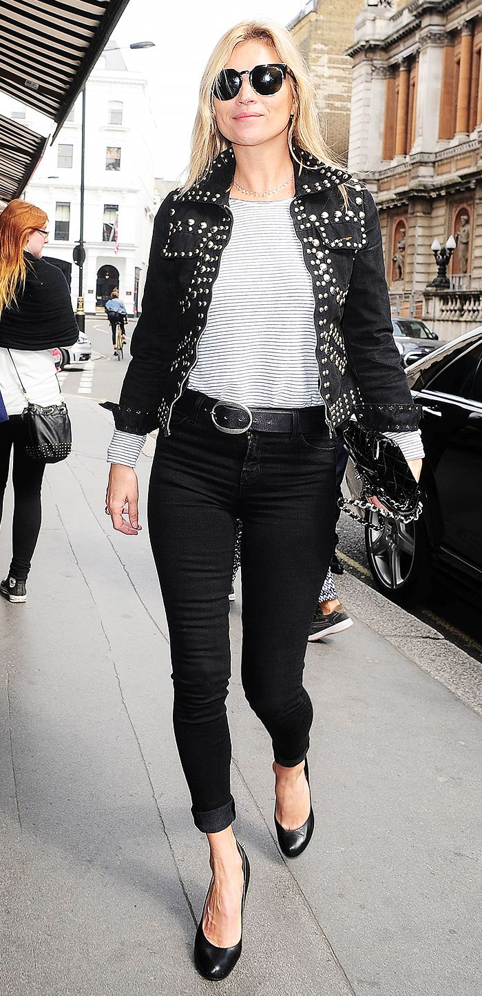 Kate Moss in a striped shirt, vintage jacket, and black jeans
