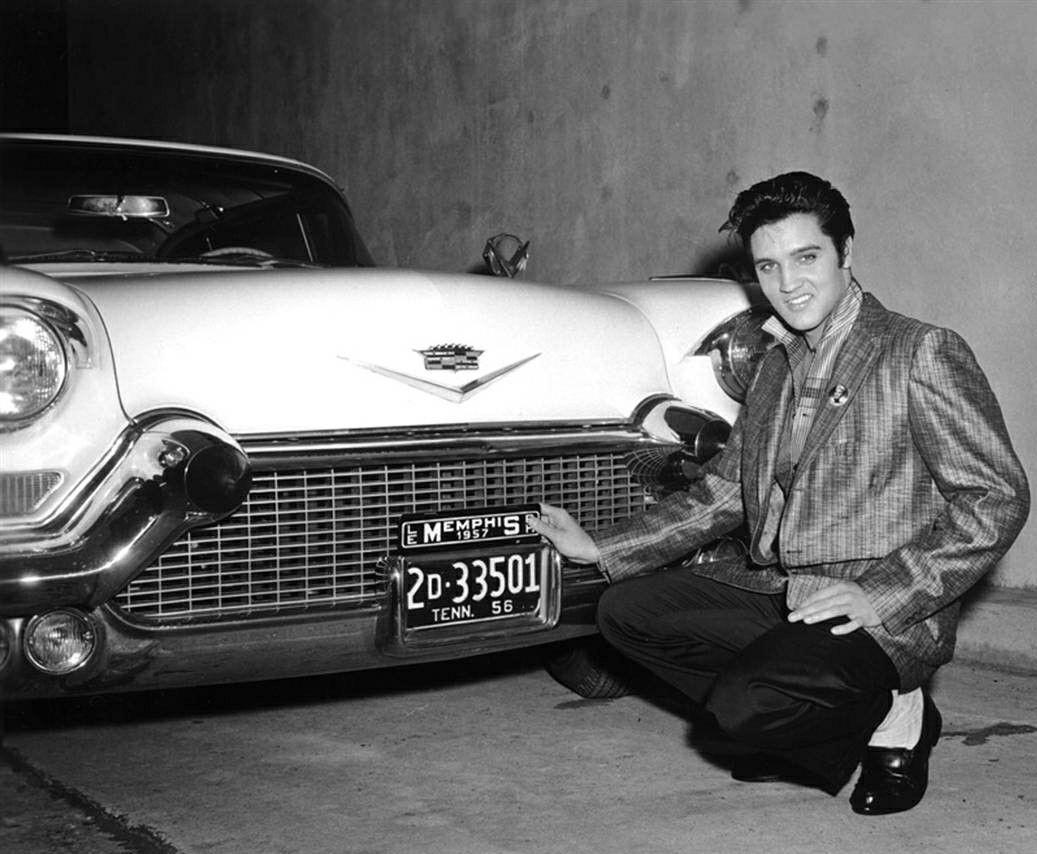 Elvis Presley with his 1957 Cadillac Eldorado Seville coupe.