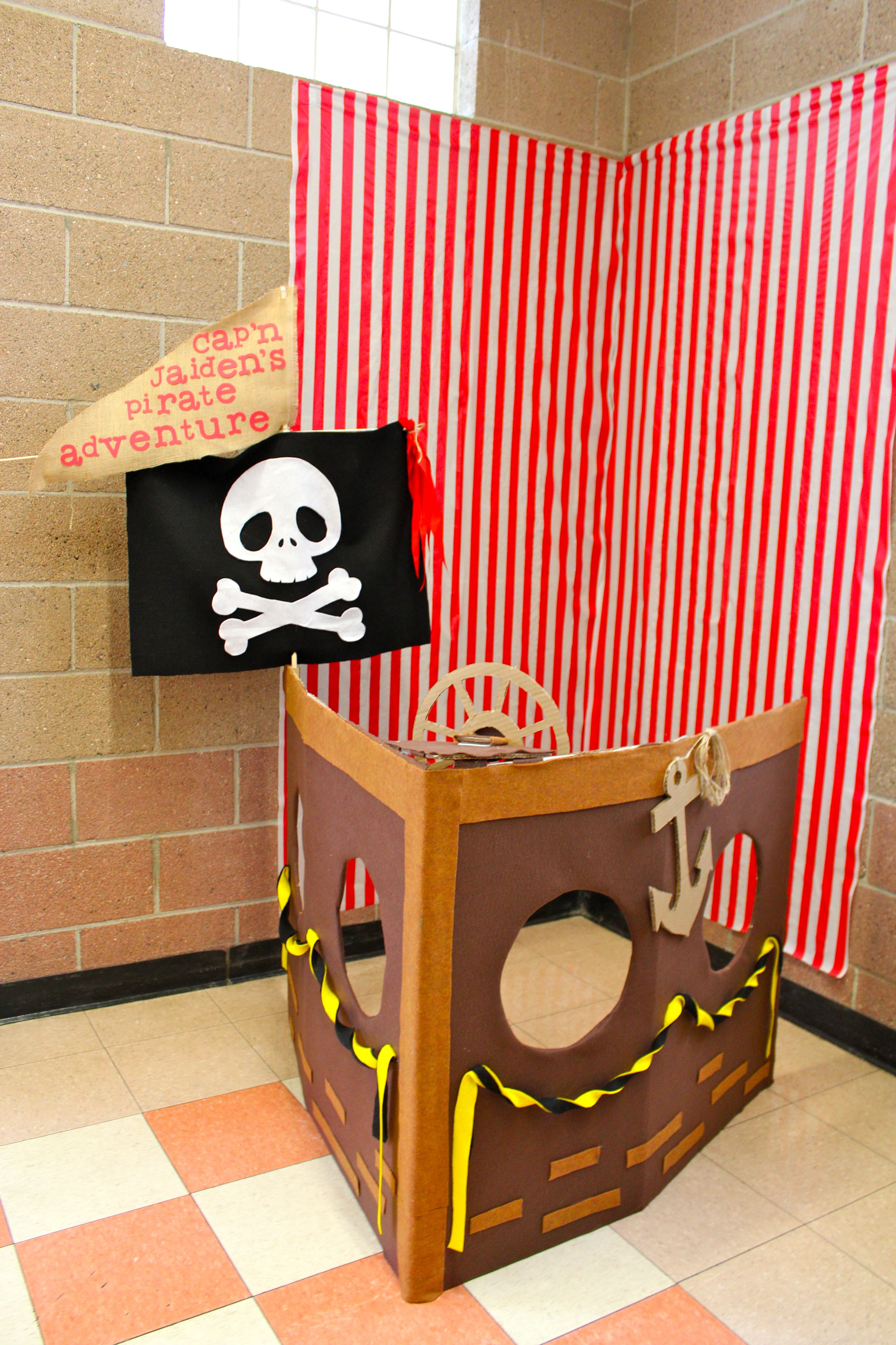 picture backdrop: i made a pirate ship boat with a #balikbayan box. Lined and decorated with felt. I made the wheel turnable and the kids had fun turning the wheel while taking their picture.