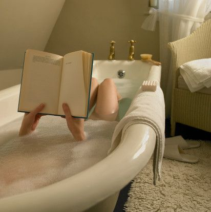 Photo of Reading a book in the bath, especially if you can find a roll-top bath, is a lit…