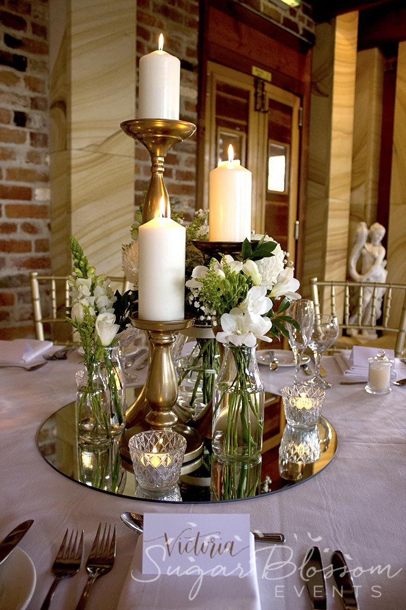 Classic White And Gold Wedding Table Centrepieces The Candlelight Reflecting In The Mirrors Was So Wedding Table Centerpieces Wedding Table Table Centerpieces
