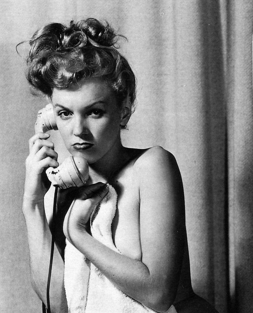 Marilyn Monroe by Earl Moran prof the messy bun has always been