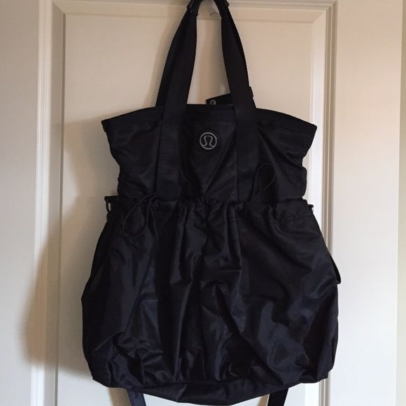 Lululemon flow and go black tote Awesome bag!  Gently used. Shoulder strap is detachable. Holds yoga mat.  Lots of storage. Non smoking home. lululemon athletica Bags Totes