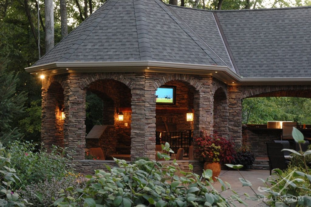 A large 8-sided stone pavilion and adjacent outdoor ... on Small Backyard Entertainment Area Ideas id=57136