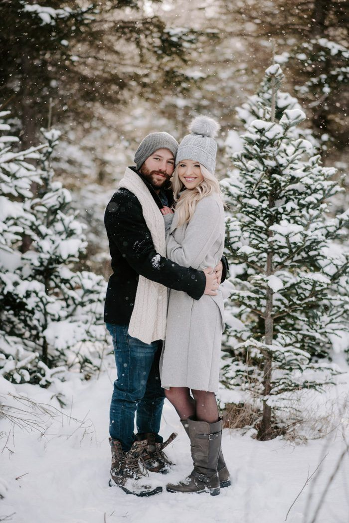 We're Totally Obsessed with These Winter Engagement Photo Outfit Ideas | Junebug Weddings -  Over on the blog: Winter Engagement Photo Outfit Ideas | Image by Christina Stripe Photography  - #bohoEngagementPhotos #Engagement #EngagementPhotosathome #EngagementPhotoscasual #EngagementPhotosdowntown #EngagementPhotosprops #EngagementPhotossnow #EngagementPhotosvintage #Ideas #Junebug #Obsessed #Outfit #photo #Totally #urbanEngagementPhotos #Weddings #Winter