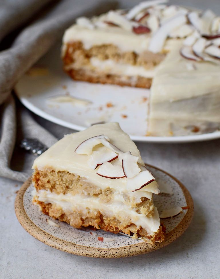 Moist And Creamy Vegan Coconut Cake With A Coconutty Sweet Potato Frosting Which Reminds Of Raffaello The R Vegan Cake Recipes Vegan Coconut Cake Vegan Bakery