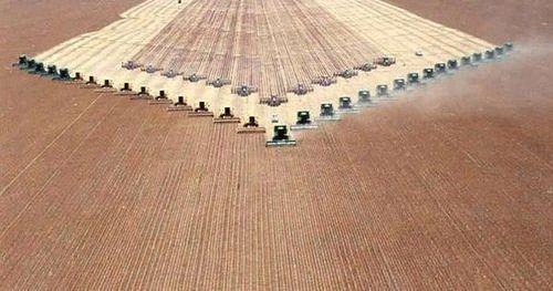 Combine harvester fleet heavy equipment farm by Cledus Snow