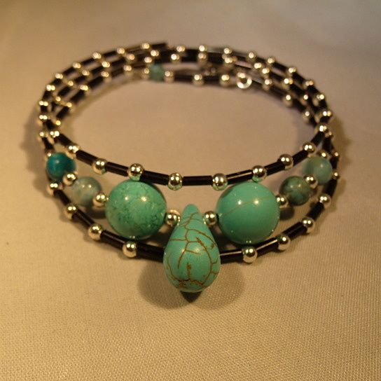 Black glass beads with turquoise