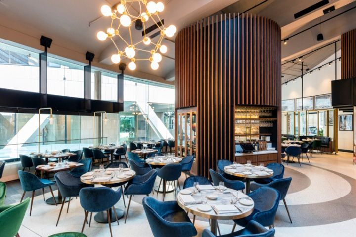 the restaurant is set across three of the buildings lower floors and boasts an interior design thats clearly inspired by midcentury aesthetics
