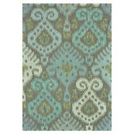 Hooked wool rug in grey and mist with an oversized ikat motif. Handmade in India.  Product: RugConstruction Material: 100% WoolColor: Grey and mist