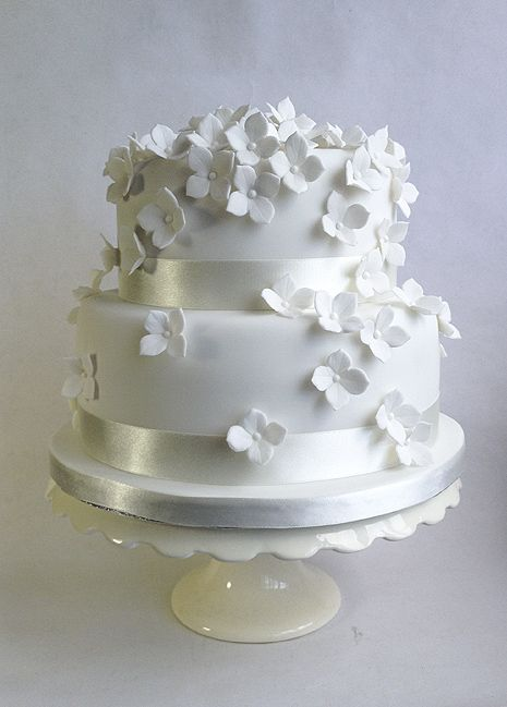 Two tier wedding cake Small and simple White cake with purple