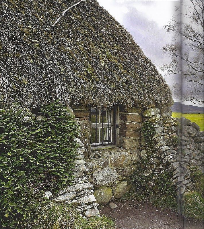 Thatched Roof Stone Cottage