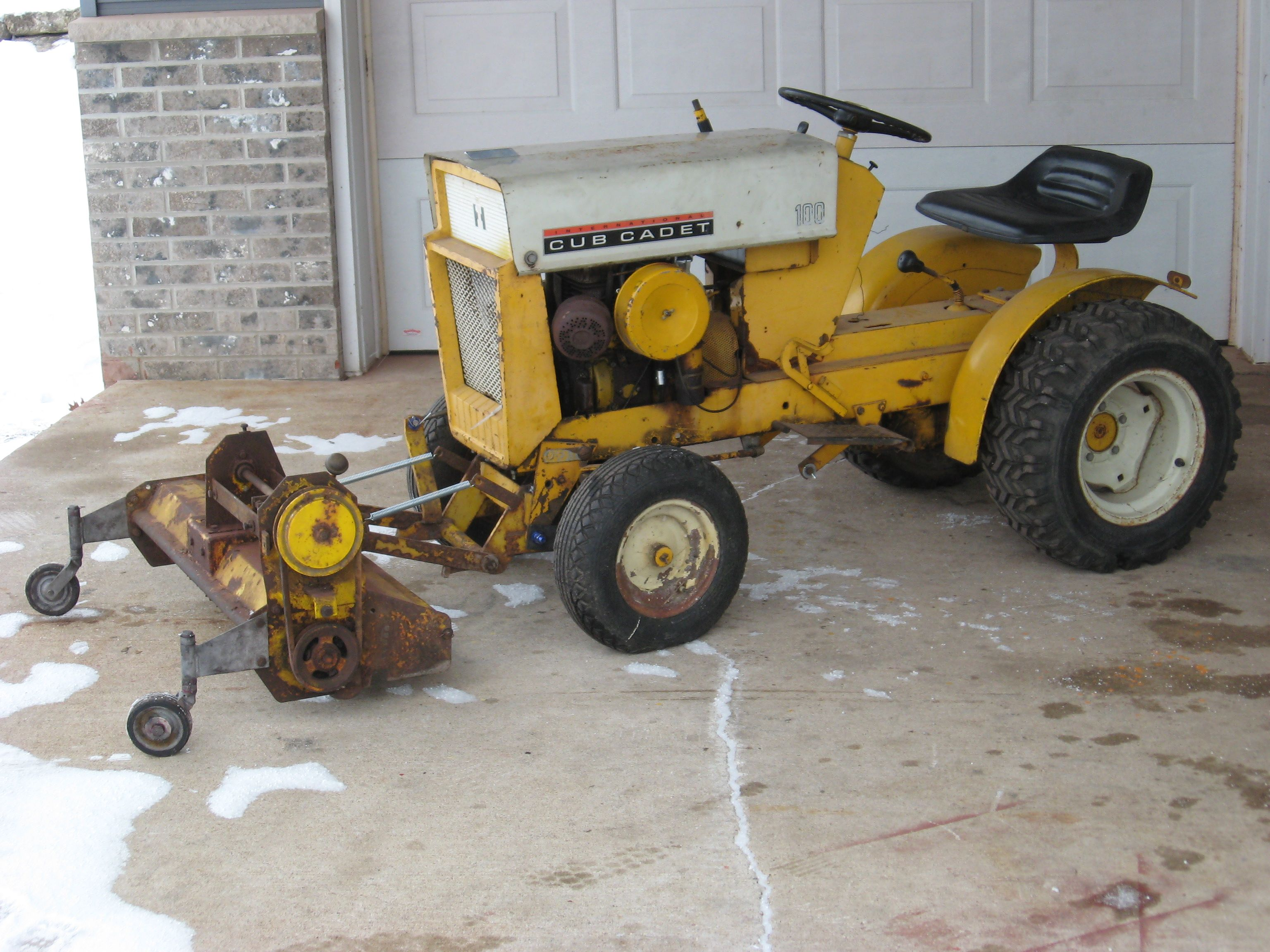 Cub Cadet 100 with a front mounted Mott Flail Mower