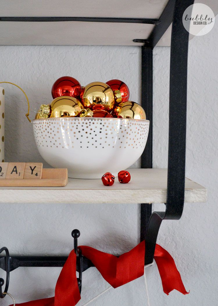 A pile of shiny ornaments in a bowl are an easy Christmas decoration
