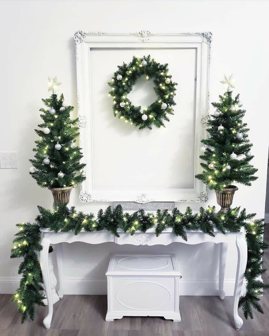 Get 10% off this already ON-SALE 4-piece set of evergreen pre-lit garland, wreath and topiaries from King of Christmas. Use code THEFOODIESFITHOME at checkout for an additional discount! #christmastopiarytrees #prelitwreath #prelitchristmastree #prelittree #christmastreesale #holidaysales #discounts #christmascoupon #christmastopiaries #tabletoptree #christmasgoals #affordablechristmastrees #holidayhomeinspo #holidaydeorinspo #holidaydecorgoals #kingofchristmas #holidaydecor #holidaytree