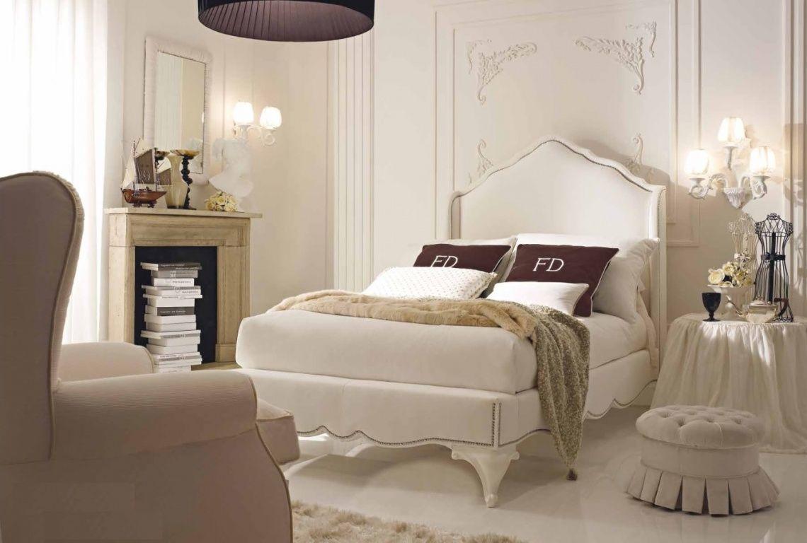 1221 Dormitorio con cabecero tapizado con orejas y bancada ...